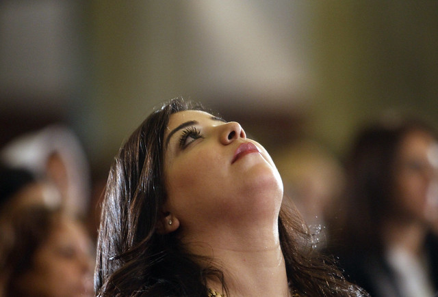 Egyptian Coptic Christian Woman Reflects at Midnight Mass