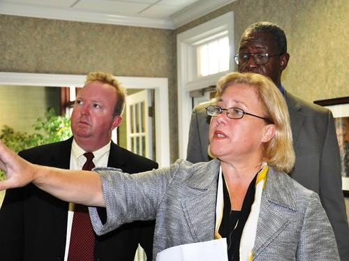 From left to right; T. Bradley Keith, State Director of Senator Landrieu's Office; Senator Mary Landrieu, and Clarence W. Hawkins, USDA Rural Development State Director, review a map of a broadband service area.  The project is funded by USDA through the Recovery Act.