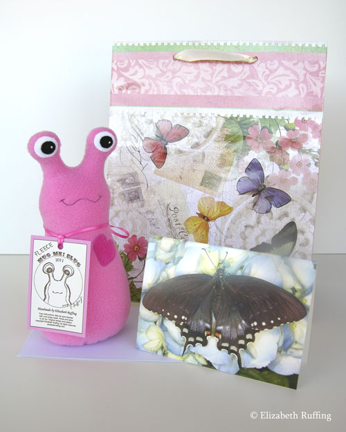 Medium Pink Fleece Hug Me Slug by Elizabeth Ruffing, with baby shower gift wrap and card