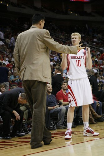 November 24th, 2010 - Yao Ming offers some strategic advice during a timeout against the Warriors