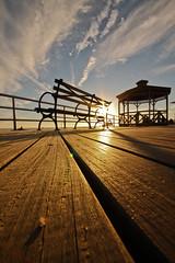 Evening Sunlight Coney Island (Explore) (Geraint Rowland Photography) Tags: wood sunset sky newyork beach clouds america bench coneyisland waiting grain promenade northamerica coneyislandnewyork geraintrowland geezaweezer