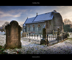 Cockley Cley All Saints Church Norfolk UK (Mr Instructor) Tags: uk blue windows winter sky snow cold history church grass nikon iron doors all religion towers norfolk saints graves east adobe freeze round fencing hdr anglia wrought cley d90 photomatix tonemapped cs5 cockley