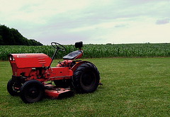 rural (sheisblahblahblah) Tags: orange tractor field grass rural big corn farm fields farms crops acre