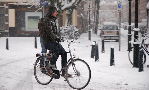 smiling and cycling in the snow