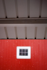 let it snow. (solecism) Tags: winter red snow blur window barn farm cyclops eaves fauxdiptych
