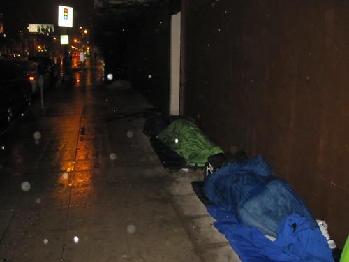 homeless sleeping in rain