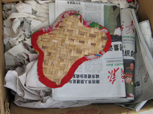 Woven needle and thread box on some newspapers