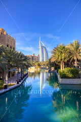 Madinat Jumeira and Burj Al Arab in background (fototrav) Tags: city travel blue summer sky sunlight color building tree tourism water architecture stars photography hotel photo saturated dubai day photographer uae middleeast 7 nobody palm seven burjalarab luxury unitedarabemirates hdr jumeira jumeirah madinat abudabi fototrav