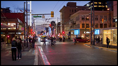 Twilight at Granville and Robson (Eric Flexyourhead) Tags: street city people urban canada vancouver evening twilight downtown cityscape bc britishcolumbia pedestrians intersection bluehour 169 streetscape robsonstreet shoppers commuters granvillestreet olympusep1 panasoniclumix20mmf17