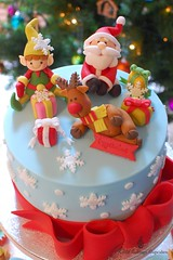 It's Christmas!! (Little Cottage Cupcakes) Tags: santa christmas cakes cake snowflakes cupcakes presents bow ribbon rudolph reindeers elves fondant cupcaketower sugarpaste littlecottagecupcakes
