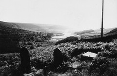 St James Chapel, Woodhead. (Holly Hayward) Tags: uk trees england bw sun white lake black film church grave graveyard 35mm woodland photography photo glare chapel graves reservoir pylon photograph pylons shrubs stjames woodhead crowden hollyhayward