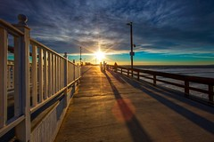 happy fence friday (Eric 5D Mark III) Tags: ocean california light sunset shadow sky cloud seascape beach canon fence landscape happy pier vanishingpoint perspective wideangle newportbeach orangecounty friday hff sunbursts ef14mmf28liiusm eos5dmarkii