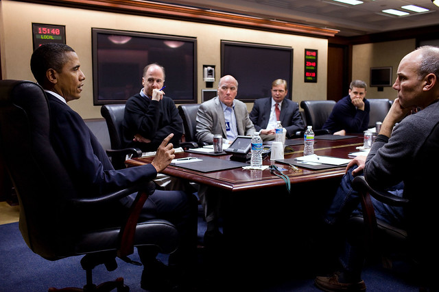 President Barack Obama takes part in a conference call in the Situation Room of the White House concerning the shooting of Rep. Gabrielle Giffords and others in Tucson, Az., Saturday, Jan. 8, 2011. Pictured, left to right, National Security Advisor Tom Donilon, incoming Chief of Staff Bill Daley, Deputy Chief of Staff Jim Messina, Director of Communications Dan Pfeiffer, and Assistant to the President for Legislative Affairs Phil Schiliro. Also taking part in the call were Attorney General Eric H. Holder, Jr., Homeland Security Secretary Janet Napolitano, and FBI Director Robert Mueller (Official White House Photo by Pete Souza)