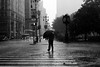 Struggling, Crossing, Sinking (Airicsson) Tags: street new york city nyc summer urban blackandwhite bw usa white ny black rain island lumix us walk manhattan panasonic rainy 2010 streetshot lx3