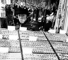 10/365: The Mysterious Ring Seller (joyjwaller) Tags: blackandwhite face hat japan sketchy tokyo commerce rings harajuku merchant suspicion walkby timetraveler project365 theyamanotelinepilgrimage