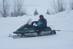 Vivianne & Uncle Daniel on the snowmobile