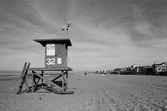 (Lil.Ortiz) Tags: california blackandwhite film beach trix newportbeach socal lifeguardstation beachtown