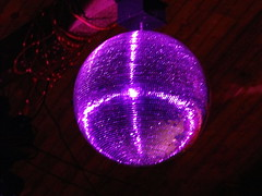Purple Light Shines On A Disco Light Inside The Gazebo Building.