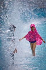 Muslim girl playing in the water outside of the Petronas Twin Towers in Kuala Lumpur (yipe) Tags: pink girl swimming swim women muslim clothed hijab womens rights malaysia kuala splash niqab kl lumpur fully