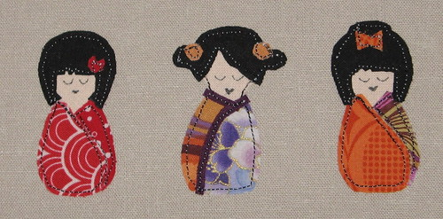 closeup of Kokeshi doll applique hoop