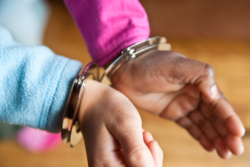childrens' hands cuffed photo
