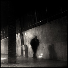 Man on rain (joanpetrus) Tags: street light shadow blackandwhite bw white man black 6x6 rain night composition square outside lumix mono europe flickr solitude december alone shadows darkness noiretblanc candid steps creative citylife atmosphere monotone bn panasonic explore human squareformat older pancake 20mm oniric cinematic schwarzweiss desolation 43 blancinegre streetshot virado olderman 500x500 gf1 pancakelens bwd bwdreams leicalens incoloro