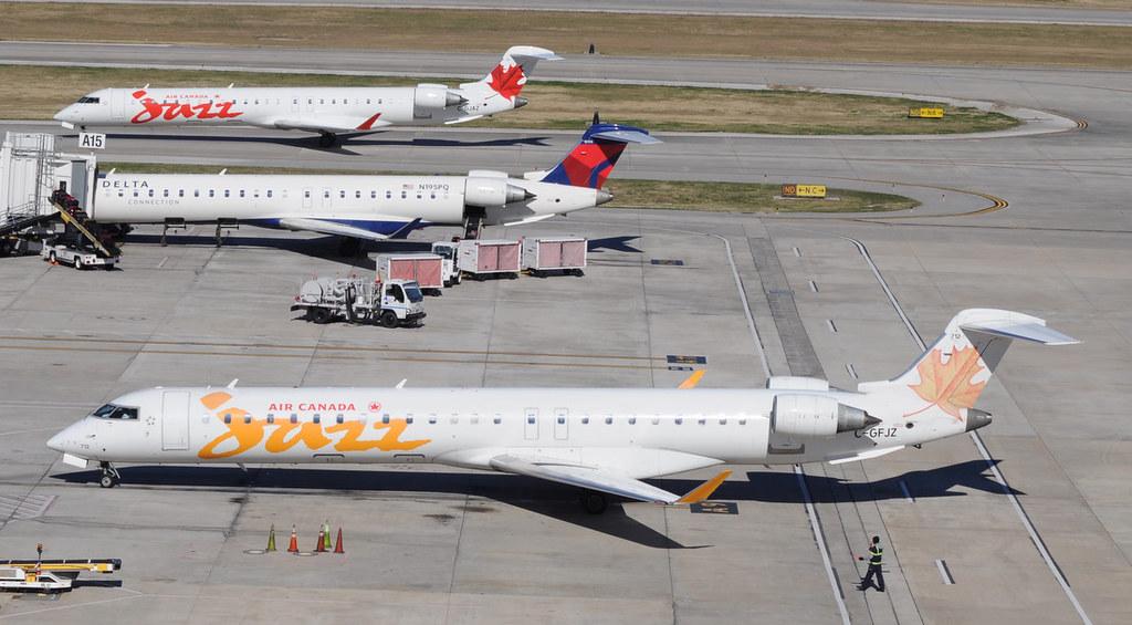 Three Bombardier CRJ Model 900 Series airliners