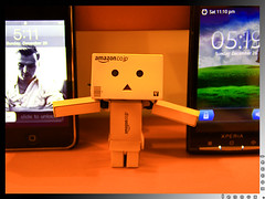 "Explored:  ""Hey Danbo, Pick One... iPhone or xPERIA?"" (lennox_tpc) Tags: world life canon toys eos amazing still explore dslr discovery cellphones iphone danbo 18200mm explored 60d xperia"