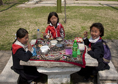 Picnic time for young pioneers - Pyongyang North Korea (Eric Lafforgue) Tags: people food color colour childhood dedication horizontal youth children person kid war asia child redribbon propaganda capital korea jeunesse communism meal devotion innocence asie enfants capitale coree enfant nourriture naivete personne couleur humanbeing communisme northkorea repas pyongyang dprk propagande enfance coreadelnorte rubanrouge lookingatcamera nordkorea colorpicture waistup 3658 fervour democraticpeoplesrepublicofkorea  devouement   coreadelnord  ferveur etrehumain coreedunord  insidenorthkorea  rpdc  regardantlobjectif kimjongun coreiadonorte  republiquepopulairedemocratiquedecoree cadragealataille