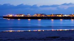 Santa Cruz Wharf (Chris Saulit) Tags: ocean california santacruz reflection beach water northerncalifornia lights coast pier waves dusk wharf boardwalk bluehour norcal heurebleue