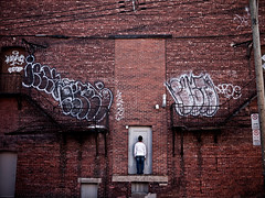 (ssj_george) Tags: road street door red canada man male wall stairs standing lens four lumix person alley alone plateau montreal bricks royal panasonic single micro pancake 20mm mont dmc thirds f17 m43 gf1 bricked 43rds georgestavrinos ssjgeorge