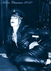 black leather mistress look webcam shot. London uk 2010 (Karen Chessman: In Trans Umbraculis Fetish Luminis) Tags: france mannequin leather fashion fetish photography high model glamour uniform photos top dom military gothic moda lifestyle skirt karen tgirl transgender cap tranny transvestite heels glam trans mistress fashionista transexual mode crossdresser pelle leder alternative kinky femdom dominatrix domina allure modele glamorous cuero dominatrice cuir fetisch travesti maitresse transexuelle transgenders lifestyler transgenre karenchessman ledermode