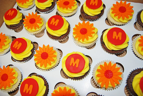 Red and Orange daisy and monogram cupcakes