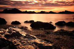 Lover's Island Beach (Jo_Krazy) Tags: sunset sea beach water rocks long exposure cove silhouettes pebbles nd4grad