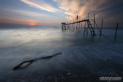 a driftwood, a jetty and a fisherman (acidsulfurik) Tags: fisherman jetty driftwood nd slowshutter jeram kualaselangor cokinnd8filter pantaijeram jerambeach filtersunsethigh tidecomposition