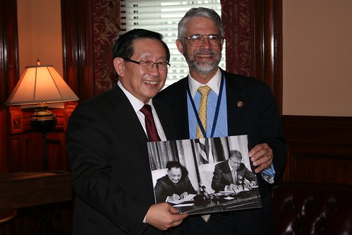 OSTP Director John P. Holdren and the Minister of Science and Technology for the People's Republic of China Wan Gang hold a photograph of U.S. President Jimmy Carter and Chinese Premier Deng Xiaoping signing the original U.S.-China Agreement on Cooperation in Science and Technology in 1979.