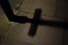 Lamp post shadow (fabiolug) Tags: winter light shadow black london dark pavement lamppost cracks lookingdown londonist gf1 pancakelens microfourthirds panasoniclumixgf1 panasoniclumix20mmf17