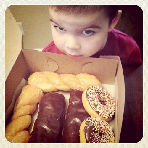 Project 365 37/365: Someone wants to jump right into the Sunday morning box of donuts.