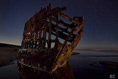 Rest in Pieces (Ben Canales) Tags: ocean longexposure reflection beach water night oregon dark stars star coast sand rust ship ben decay vessel peter shore starry fortstevens peteriredale canales iredale ftstevens bencanales thestartrail