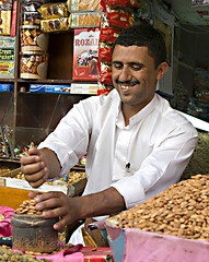 yemeni almond (Khalid Alkainaey  ) Tags: life travel people tourism beauty face photography inflight image muslim islam picture middleeast arab yemen sanaa aden   yemeni yaman      ymen yemenia jemen  arabiafelix     arabianpeninsula iemen           yemenphotos    republicofyemen   yemenairways   yemenpicture    lifeandpeople   yemeniamagazine   traditionalcostumeofyemen yemenimages  inyemen