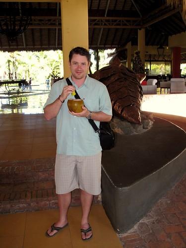 Enjoying a Delicious Coconut Beverage