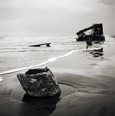we had truly missed the boat (manyfires) Tags: ocean sea blackandwhite bw film water mediumformat landscape sand rust waves pacific northwest shoreline stevens hasselblad pacificocean shipwreck astoria wreck peteriredale modestmouse fot hasselblad500cm missedtheboat