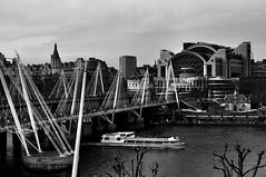 Hungerford Bridge (Waterloo) 2 (dave.osborne) Tags: bridge shadow sky cloud london tourism scale monochrome thames contrast river dark grey boat gray southbank waterloo embankment hungerfordbridge southbankcentre playhousetheatre waterloofootbridge