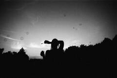 surrounded (seahorserider) Tags: portrait sky blackandwhite film 35mm fun blackwhite bubbles roadtrip