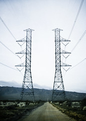 March 20, 2011  [Day 79] (BrandonJPeterson) Tags: road lines vintage holga power desert bright towers creepy powerlines dirt electricity telephonewires