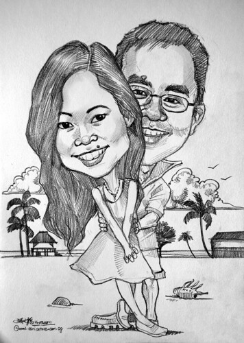 Couple caricatures at Malaysia beach