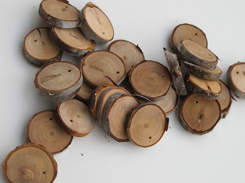 Wood coins cut and drilled by Papa