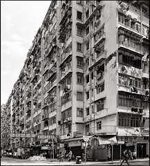a block within a city of commercial (d.teil) Tags: china city sky hk house building architecture facade asia haus cage east hong kong architect housing tall eng kok density dense mong dwellings huser dwelling enge hoch dteil