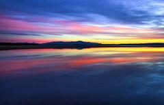 Lake Winnipesaukee (Robert Allan Clifford) Tags: nh newhampshire clouds lake lakewinnipesaukee landscape light mountain mountains reflection robcliffordphotography robertallanclifford robertclifford robertallancliffordcom scenic sky view water waterscape sunrise