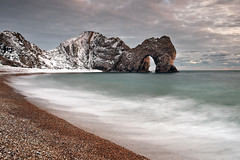 Durdle Door (peterspencer49) Tags: ocean uk winter england sky snow seascape beach clouds coast chalk europe waves unitedkingdom britain pebbles dorset stunning limestone coastline oceanview seaview coastalpath westcountry southwestcoast lulworthcove durdledoor jurassiccoast winterview rockarch southwestcoastalpath chalkcliffs stunningview manowarbay seascene cosatline oceanveiw limestonearch worldheitagesite cliffwalks visipix 5dmkll peterspencer stunningseascape archseaview beachseaview